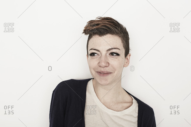 Confident woman with a faux hawk looking away
