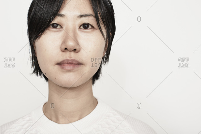 Close up of a woman in a white sweater