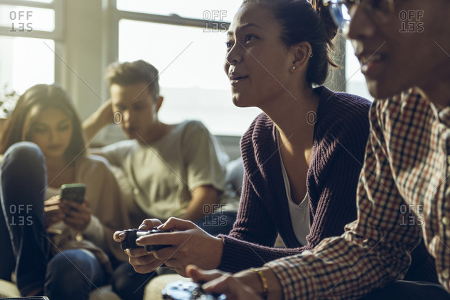 Group of friends hanging out and playing video games