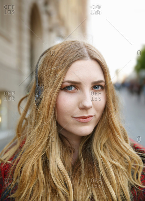 Portrait of blond young woman with headphones