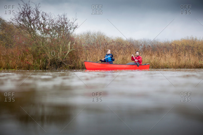 Couple canoeing from the Offset Collection