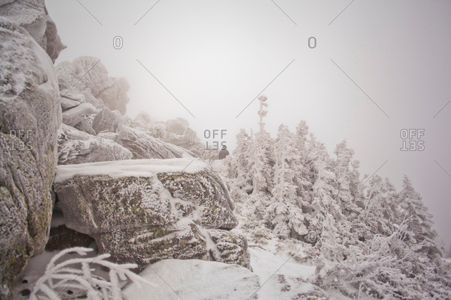 Snow covered rock formations and forest in mist, Sarsy Village, Sverdlovsk Oblast, Russia