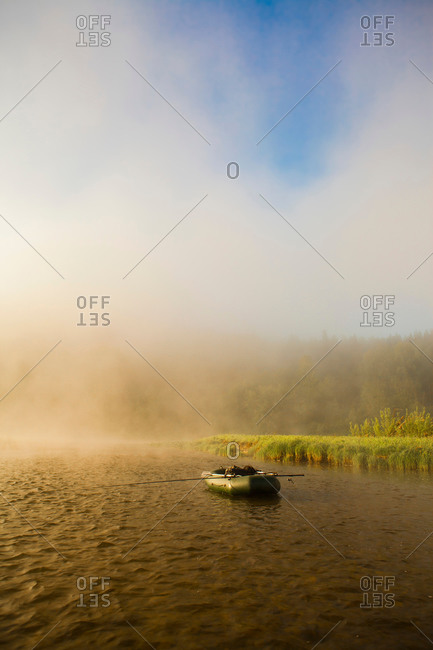 View of dinghy on misty river, Sarsy Village, Sverdlovsk Oblast, Russia