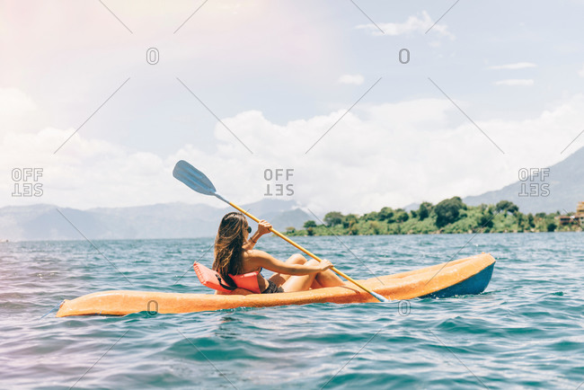 Young woman kayaking on  Lake Atitlan, Guatemala