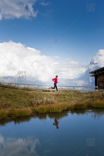Man running along lakeside, Kleine Scheidegg, Grindelwald, Switzerland