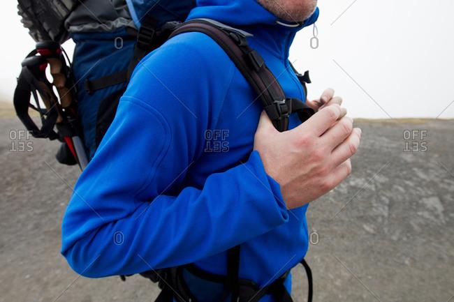 Close up of male hiker carrying backpack, Kleine Scheidegg, Grindelwald, Switzerland
