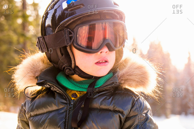 Close up portrait of boy wearing helmet and goggles, Nizhniy Tagil, Sverdlovsk Region, Russia
