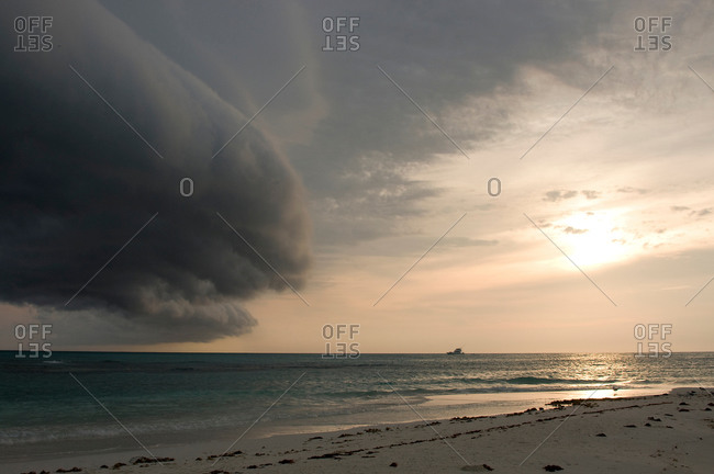 Storm clouds forming on coast of Perez Island at sunset, Gulf of Mexico