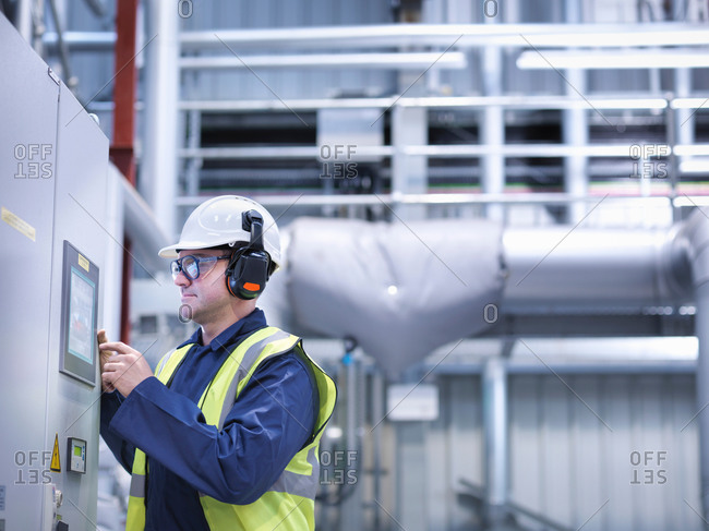 Worker using touch screen controls in gas fired power station