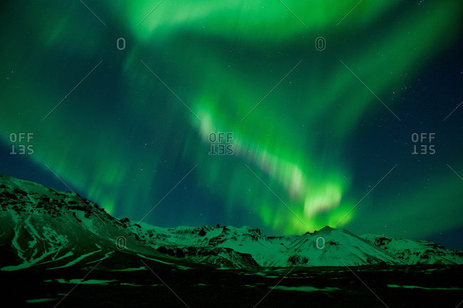 Aurora borealis above Vatnajokull glacier at night, South East Iceland