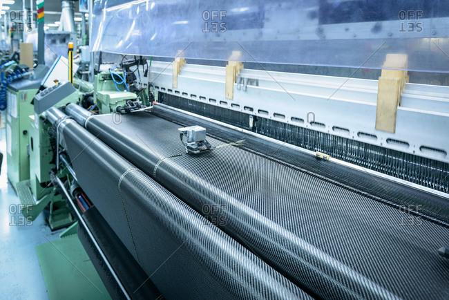 Carbon fibre loom in detail in carbon fibre factory