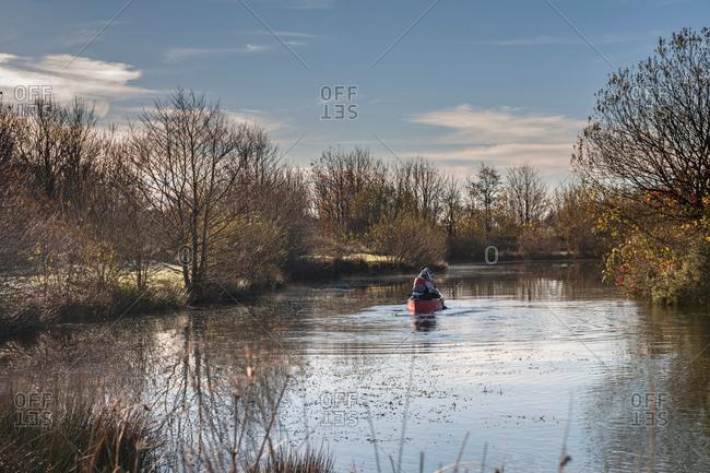 Two women in canoe on river