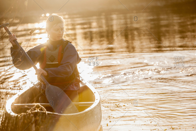 Woman canoeing from the Offset Collection