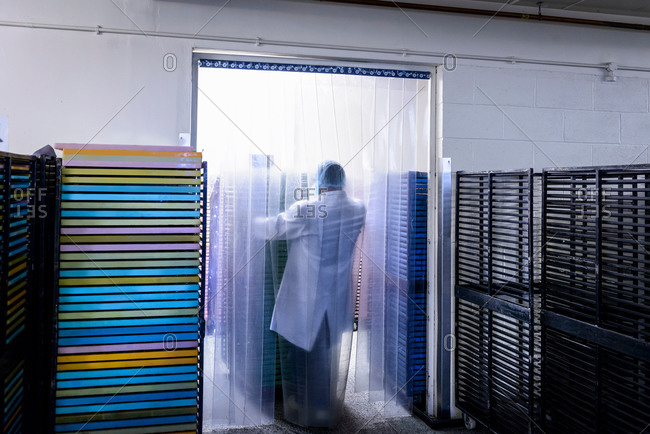 Worker moving products in chocolate factory