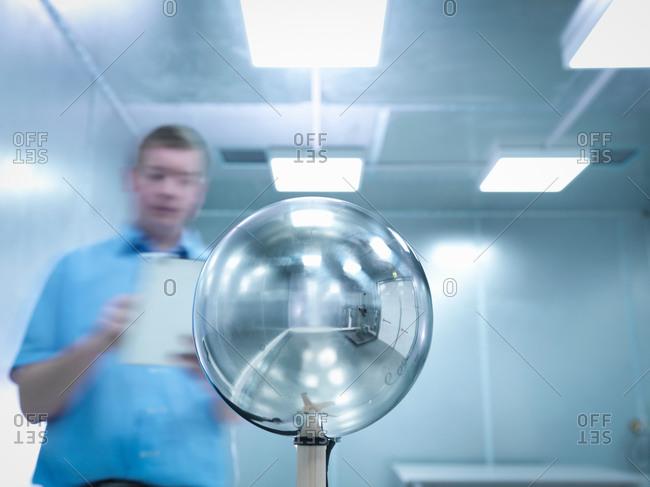 Engineer carrying out electromagnetic field (EMF) testing of electronic lighting using Van Der Hoofden Head