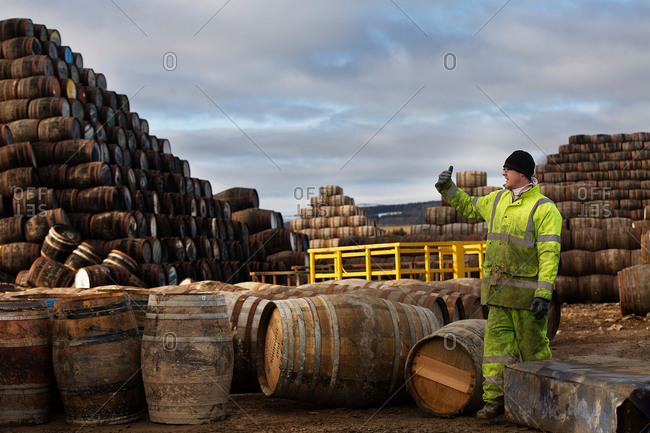 Young man working at cooperage