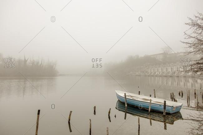 Boat moored on the river Adda near Trezzo D'Adda, Italy