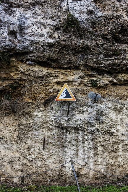 Falling rock warning sign in Trezzo D'Adda, Italy