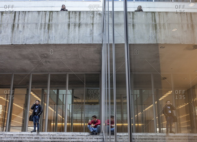 Milan, Italy - March 17, 2016: Students standing outside the Bocconi School of Management in Milan, Italy