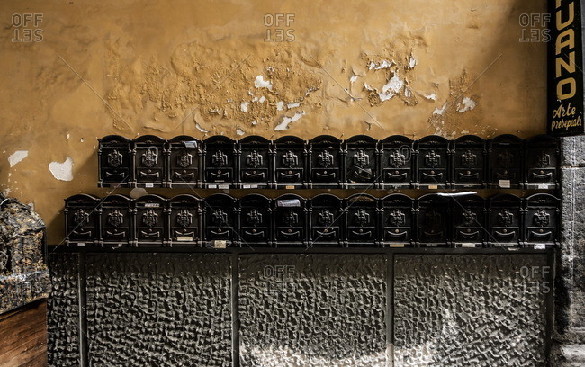 Mailboxes in a building in the Decumani area of Naples, Italy