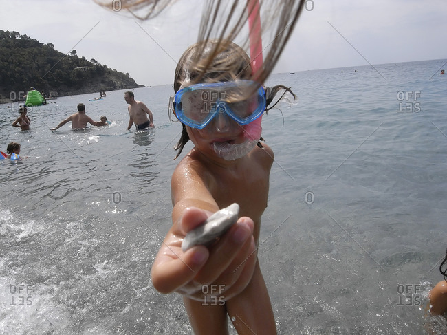 Liguria, Italy - August 8, 2009: Girl snorkeling in Liguria, Italy
