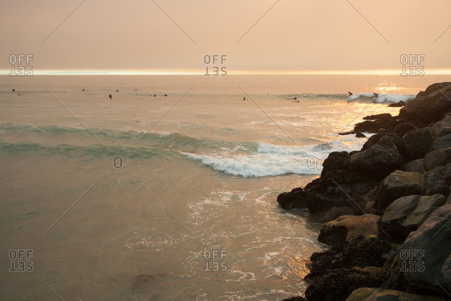 Surfers off Manhattan Beach, California