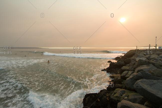 Surfers by Manhattan Beach, California