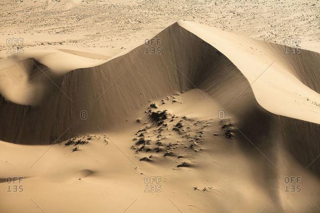 Sand dune peaks in desert