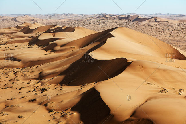 Ridge of sand dunes in desert