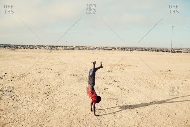 Namibian boy doing handstand