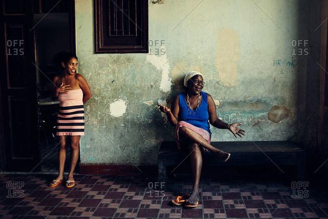 Havana, Cuba - December 17, 2015: Woman in apartment foyer, Cuba