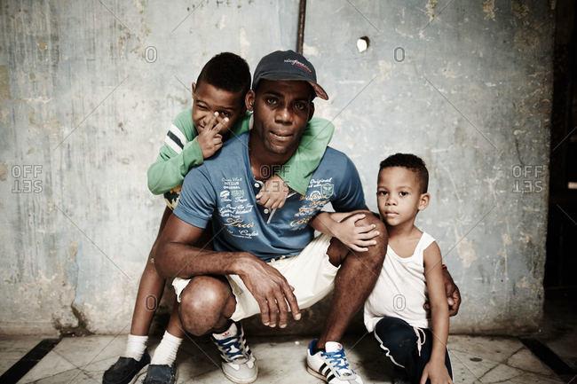 Havana, Cuba - December 8, 2015: Man with two boys, Cuba