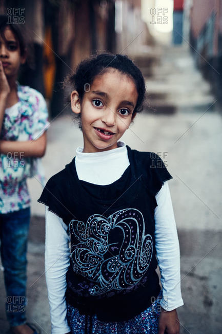 Taghazout, Morocco - February 13, 2016: Girl in street in Taghazout, Morocco