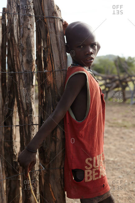 Namibia - March 17, 2016: Namibian boy leaning on fence