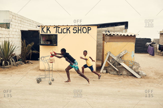 Mondesa, Namibia - March 7, 2016: Kids with shopping cart in Namibian village