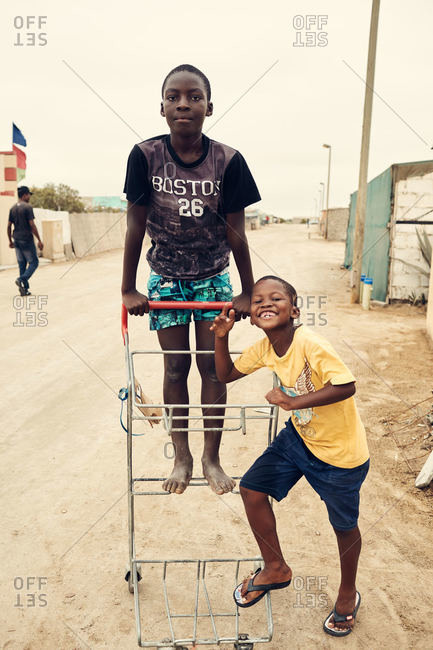 Mondesa, Namibia - March 7, 2016: Kids with cart in Namibian village