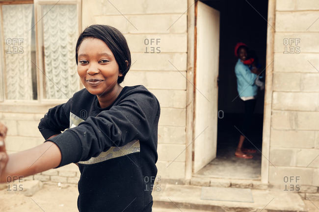 Mondesa, Namibia - March 7, 2016: Woman smiling in Namibian town