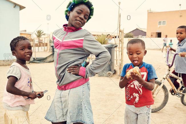 Mondesa, Namibia - March 7, 2016: Kids posing in Namibian town