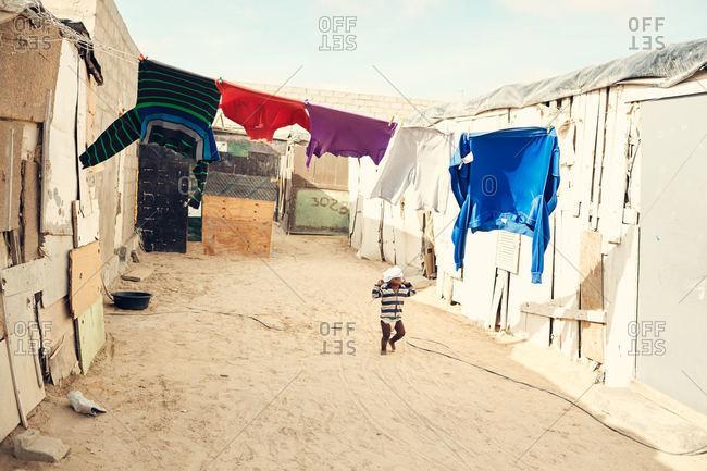 Mondesa, Namibia - March 7, 2016: Toddler walking in Namibian town
