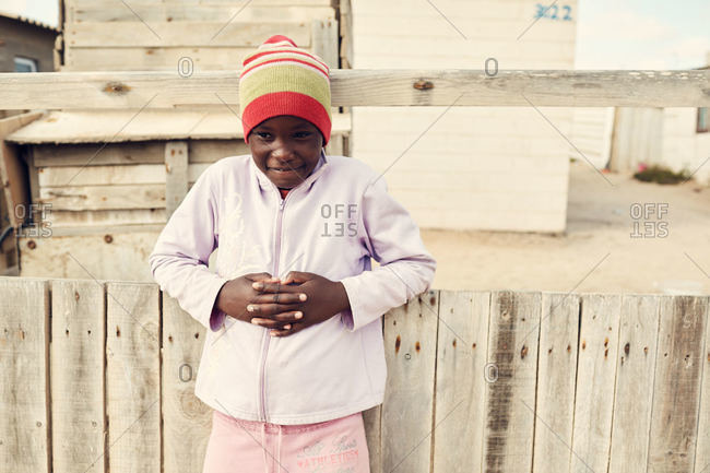 Mondesa, Namibia - March 7, 2016: Shy child in Namibian town