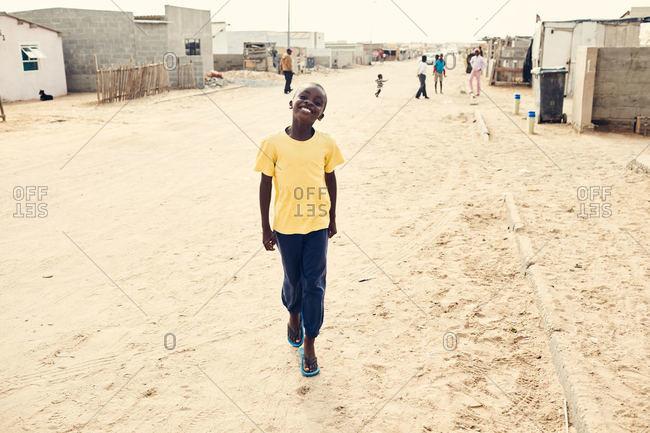 Mondesa, Namibia - March 7, 2016: Boy smiling in Namibian town
