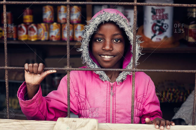 Namibia - March 7, 2016: Namibian girl at shop window