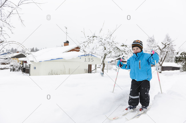 Young boy skiing in winter