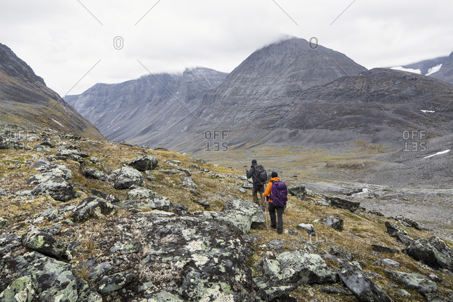 A man and a woman hiking