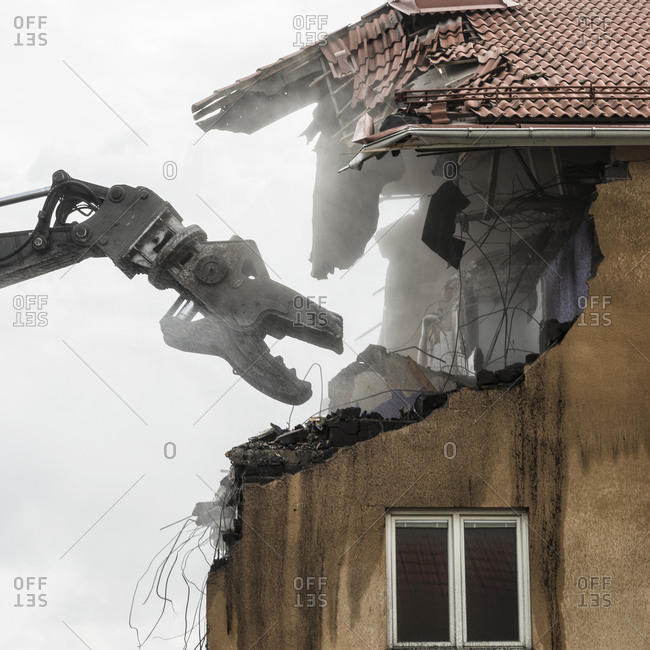 Machinery deconstructing old building - Offset