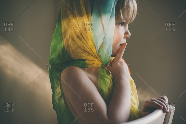 Toddler girl wearing a green scarf on her head