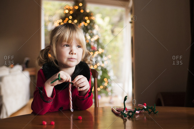 Young girl making candy cane crafts at Christmas