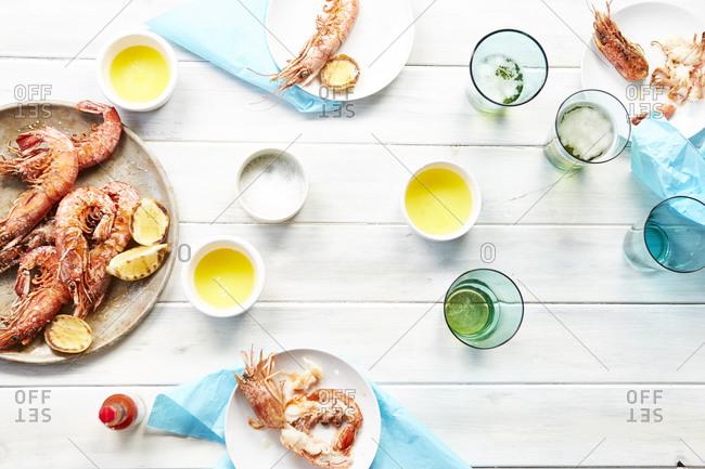 Fresh prawns served with lemon, butter, and salt