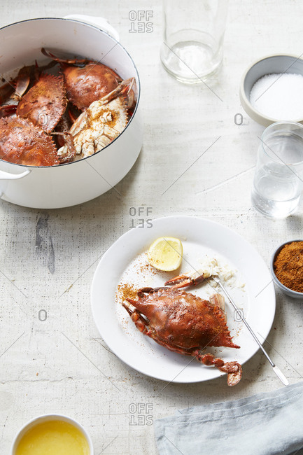 A pot of freshly cooked crabs served with butter and lemon