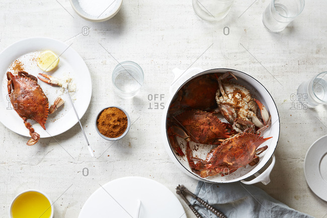 Freshly prepared crab legs served with butter and lemon